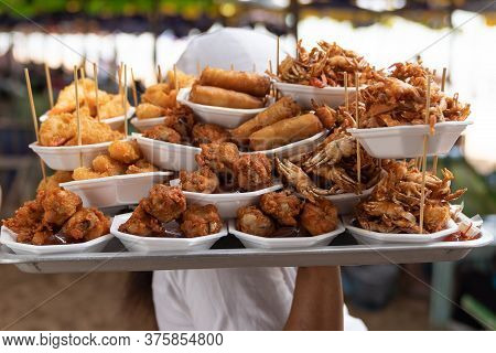 Street Sea Food On Tropical Beach Of Thailand, With Fried Food.