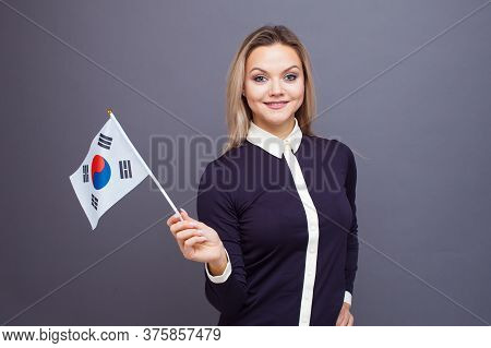 Immigration And The Study Of Foreign Languages, Concept. A Young Smiling Woman With A Republic Of Ko