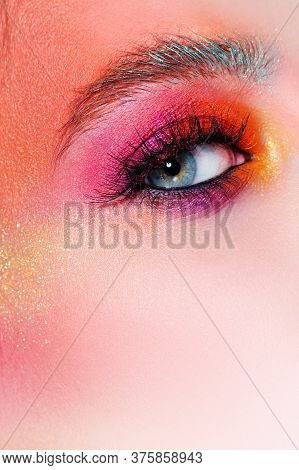 Bright Makeup And Face Art, Close-up Of The Eye. Bright Pink Eye Shadow And Glitter. Eyebrows And La