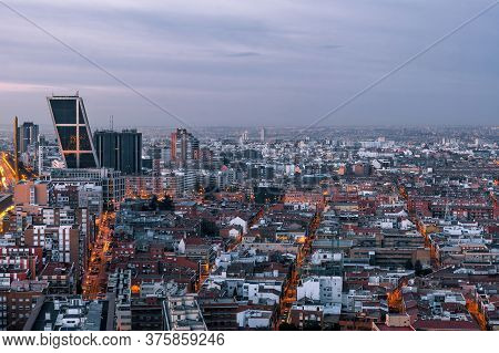 Aerial View Of Castellana And Madrid's Skyline At Dawn, With The Twin Leaning Modern Office Blocks (