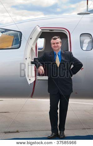 Smiling Businessman at Corporate Jet Piaggio Avanti poster