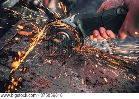 Sparks From The Rotation And Cutting Of Metal By Electric Saw Machine