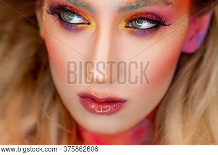 Bright Makeup And Face Art, Close-up Portrait. Creative Makeup, An Unusual Image Using Glitter And C