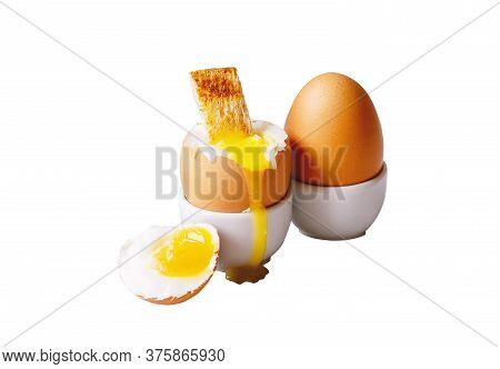 Soft-boiled Eggs In White Eggcups With Rye Crouton Isolated On White Background. Egg With Crumbs For