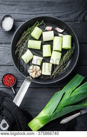 Green Leeks Sultan  Chopped Oninon On Grill Pan Uncooked With Herbs Ingredients , On Textured Black