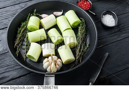 Raw Leeks Sultan  Chopped Oninon On Grill Pan Uncooked With Herbs Ingredients , On  Black Wooden Tab