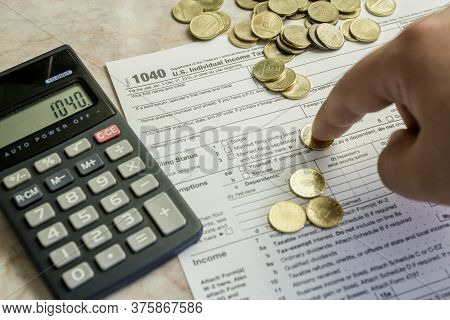 Counting Coins On 1040 Tax Form. Irs Revenue Concept