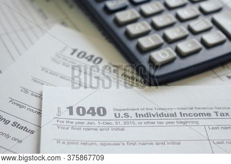 Tax Form Business Financial Concept Macro View Of Individual 1040 Return Tax Form Near A Calculator