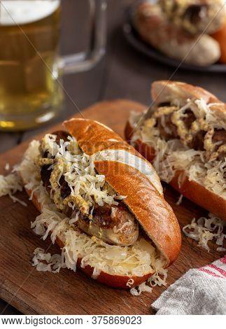 Grilled Bratwurst With Sauerkraut And Dijon Mustard On A Bun