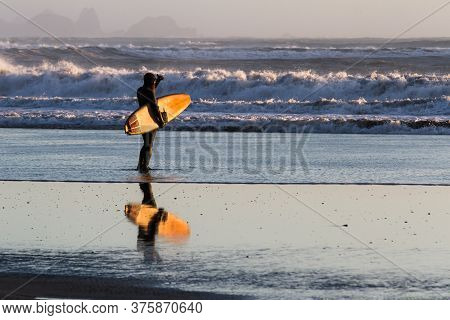 Surfing In The Oregon Coast