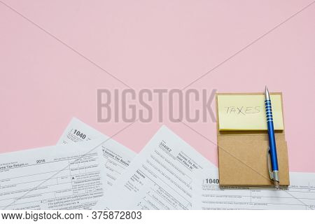 Us Tax Form 1040 With Note And Pen. Tax Form. Law Document Usa. Pink Background. Mathematics Busines