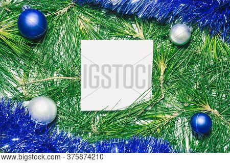 X-mas Background With Blue Decoration, Christmas Balls And Green Pine Leaves. Square Copy Space For