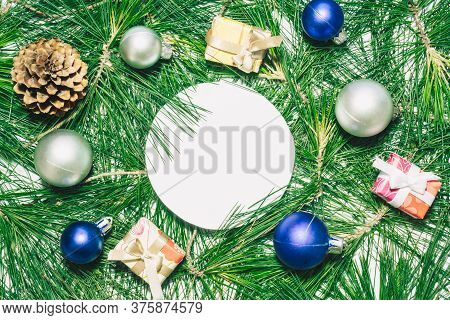 X-mas Background With Christmas Balls, Presents, Pinecones And Green Pine Leaves. Round Copy Space F