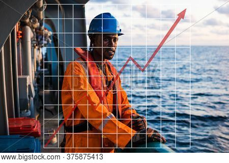 Concept Of Growth Up In Marine Industry With Rising Graphics. Seaman Ab Or Bosun On Deck Of Vessel O