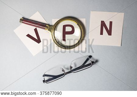 Vpn Virtual Private Network Word Acronym On Sticky Notes Paper With Magnifying Searching Glass