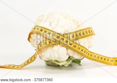 Delicious White Cauliflower With Measuring Tape Illustrating A Healthy Lifestyle Isolated On White B