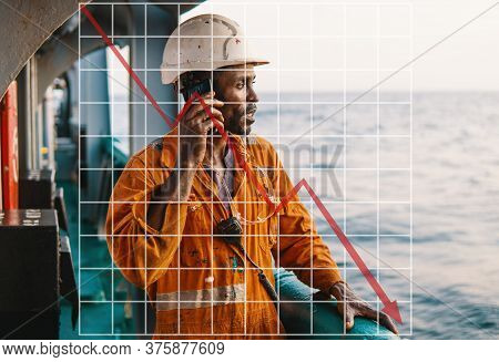 Concept Of Falling Market In Marine Industry With Downward Graphics. Bosun Or Ab Seaman On Deck Of V