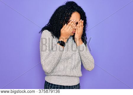 Young african american woman wearing casual sweater and glasses over purple background rubbing eyes for fatigue and headache, sleepy and tired expression. Vision problem