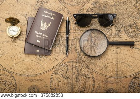 Planning Travel Concept, Thailand Passport On Old Map