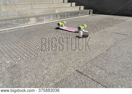 A Skateboard And A Cup Of Coffee Upside Down Fell Off The Steps. Hazardous Sports. Skateboard Injuri
