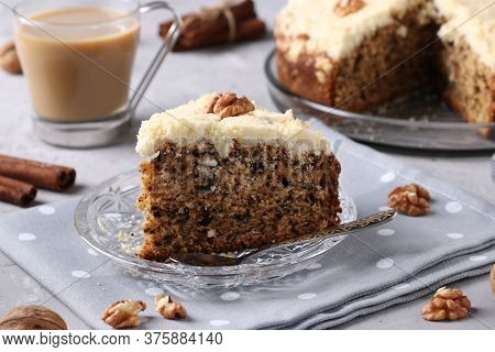Homemade Crumb Cake With Walnuts And Cinnamon In Plate On Gray Concrete Background, Horizontal Forma