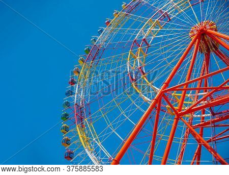 A Big Colourful Ferris Wheel Isolated On Blue Sky Background In Amusement Park Located In Vietnam, N