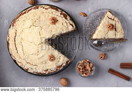 Homemade Crumb Cake With Walnuts And Cinnamon In A Plate On A Gray Concrete Background And Cut Out P
