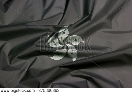 3d Illustration Of Fabric Flag Of Hong Kong In Black And White Color. The Crease Of Hong Kong Flag B