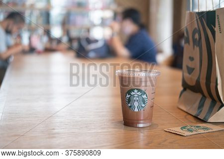 Samut Prakan, Thailand - July 11, 2020 : Glass Of Starbuck Coffee Iced Mocha Served On Wood Table In