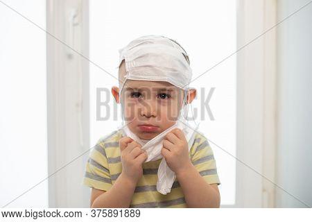 Sad Boy Wearing Many Medicine Masks, Quarantine At Home, Virus Protection