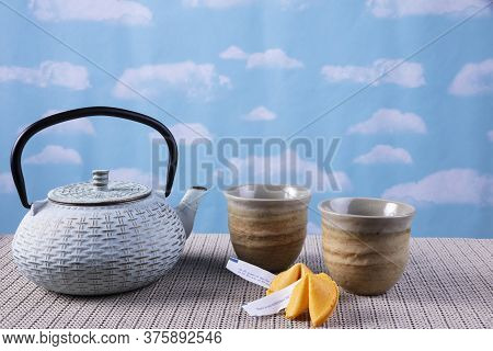 Green Tea Pot With Cups And Fortune Cookies