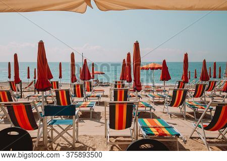 Beach Equipped With Sun Beds And Umbrellas
