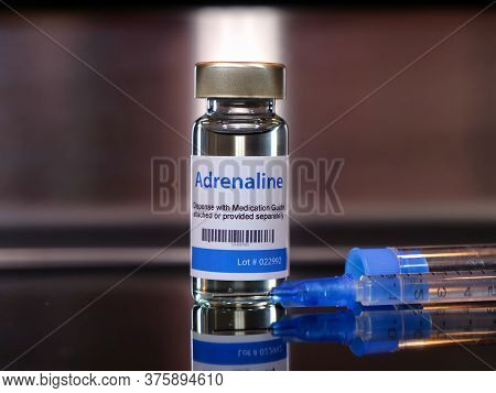Vial Of Adrenaline Injection With Syringe Concept
