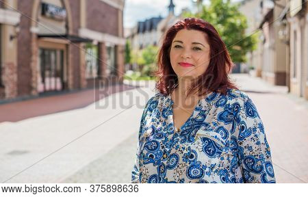 Mature Plus Size Woman, American Or European Appearance Walks And The  Enjoying Life. Lady With Exce