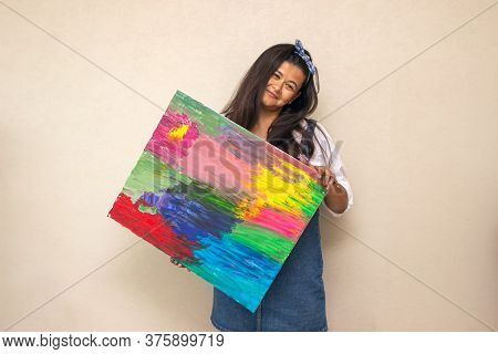 Real Talent. Beautiful Talented Woman Standing In The Studio While Showing You A Colorful Abstract P