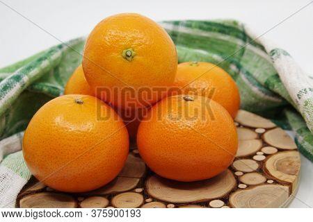 Tangerine Or Mandarin. Mandarin Isolated On White Background. Green Kitchen Towel