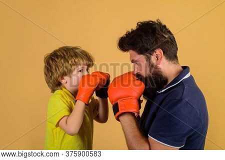 Boxing Training. Kid In Boxing Gloves Training With His Coach. Boxing Ring. Punching Knockout. Child