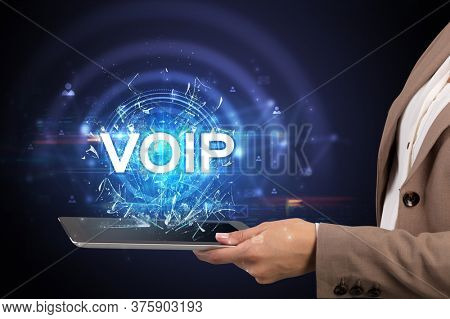 Close-up of a touchscreen with VOIP abbreviation, modern technology concept