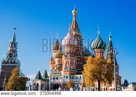 The Famous Spasskaya Tower Of Moscow Kremlin, Russia. Spasskaya Tower On The Blue Sky Background. An