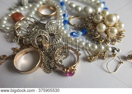 Various Jewelry Items Such As Earrings, Beads, Pearls, Chains, Crosses, Wedding Rings, Rings And Mor