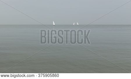 Three Sailing Yachts From The Whitstable Seafront, England