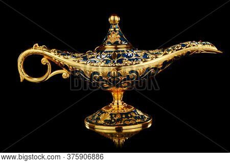 An Isolated Over Black Background Golden Magic Genies Lamp.