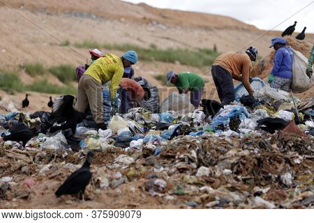 Alagoinhas, Bahia / Brazil - May 2, 2019: People Are Seen Collecting Material For Recycling In City