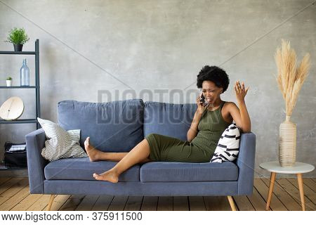Unhappy African American Woman Talking On The Phone, Angry Girl Talking On The Phone, Discharged Or