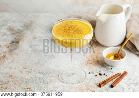 Moon Milk For Better Sleep. Turmeric Golden Milk With Cinnamon. Relaxing Drink. Ayurvedic Drink. Cop