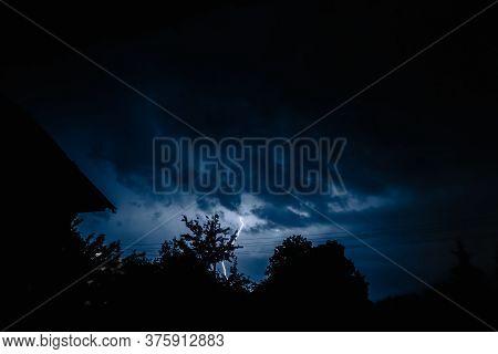 Multiple Lightening Bolts Flash Through A Dark Dramatic Sky. A Terrible Destructive Natural Phenomen