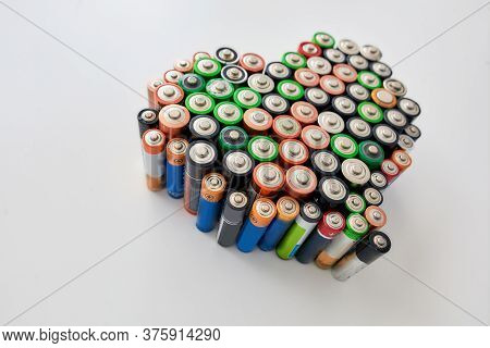 Many Alkaline Batteries On White Background. Concept Of Recycling Waste And Environmental Pollution.