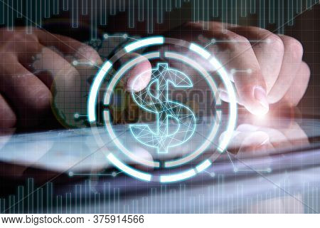 Businessman Hands Analyzing Annual Report On Digital Tablet Screen With Dollar  Hologram. Finance An