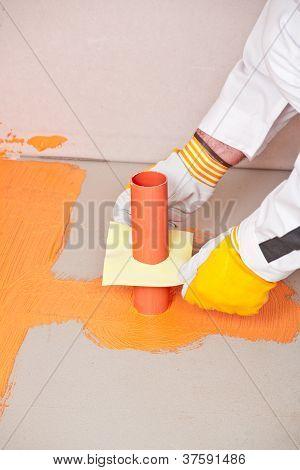 Plumber Builder Brush Applied Waterproofing On The Floor Of The Bathroom Pipe Corner Aqueduct Channe