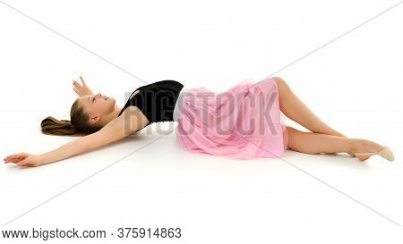 Beautiful Girl Lies On The Floor On A White Background, Portrait Of The Adorable Preteen Barefoot, L